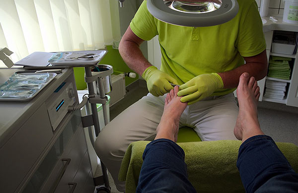 Podiatrist caring for feet